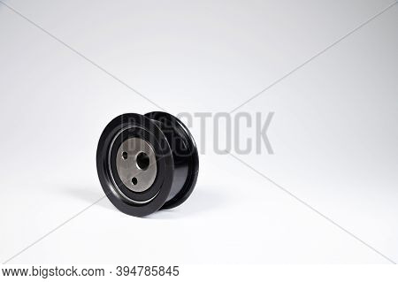 New Timing Belt Tensioner Roller Close-up Macro Shot On Gray Background