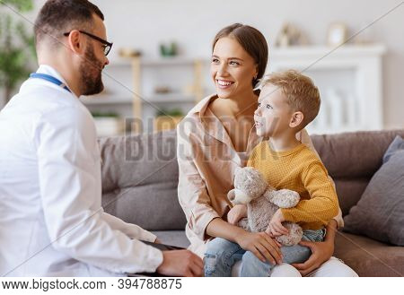 Happy Little Child Boy Patient With His Mother At The Reception Of A Friendly Pediatrician Family Do