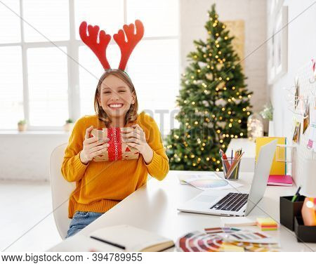 Happy Funny Girl Freelancer  Laughs And Hugs  Holiday Gift During Remote Work At Laptop At Home  Off