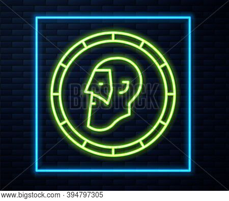 Glowing Neon Line Ancient Coin Icon Isolated On Brick Wall Background. Vector