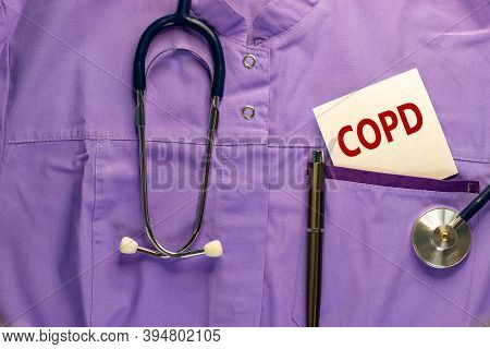 Copd Medical Concept. Medical Uniform, White Card With Words 'copd - Chronic Obstructive Pulmonary D