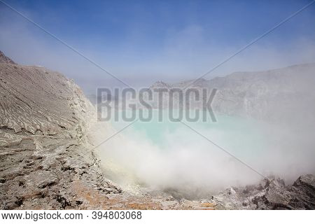 Lake In A Crater Volcano Ijen, Java, Indonesia. Lake In The Crater Of A Volcano.