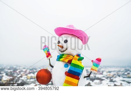 Snowwoman With Christmas Toy. Snowman Holds New Year Ball. Snow Man In Pink Hat. Christmas. Funny Sn