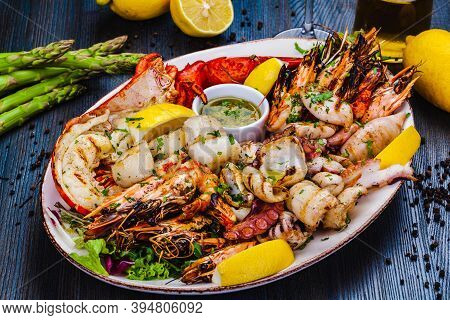 Seafood Platter.grilled Lobster, Shrimps, Scallops, Langoustines, Octopus, Squid On White Plate.