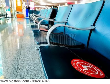 Pandemic Seating Control Measures In Place At A Large Commercial Airport. Stickers On The Seats To A