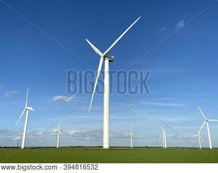 Wind Farm Turbines That Produce Electricity Energy. Windmill Wind Power Technology Productions Wind