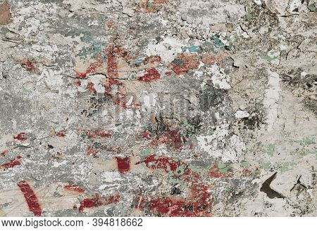 Many Colors Distressed Old Plaster Wall With Paint. Shabby Background Design. Abstract Grunge Urban