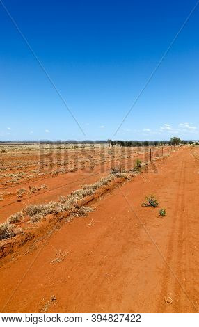 Flat Orange Drought Effected Land In Central Queensland South Of Charters Towers. Australian Outback