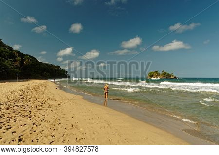 Landscape Costa Rica, National Park Cahuita On The Caribic Coast, Sand Beach With The Waves And Smal