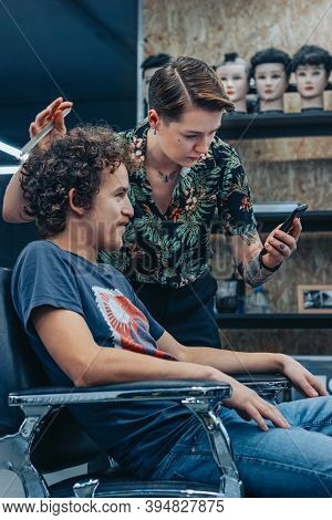 Minsk, Belarus - October 14, 2020: Barber And Visitor Discuss Details Of Hairstyle