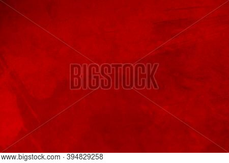 Red Matte Background Of Suede Fabric, Closeup. Velvet Texture Of Seamless Leather.felt Material Macr