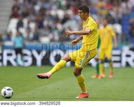 Lyon, France - June 16, 2016: Yevhen Khacheridi Of Ukraine Kicks A Ball During The Uefa Euro 2016 Ga