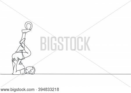 Single Continuous Line Drawing Of Young Sportive Man Train Soccer Freestyle, Hold The Ball With Toe