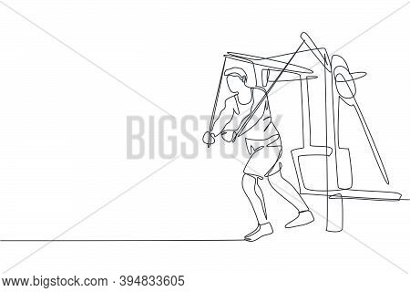 One Continuous Line Drawing Of Young Sporty Man Working Out With Crossover Cable Machine In Fitness