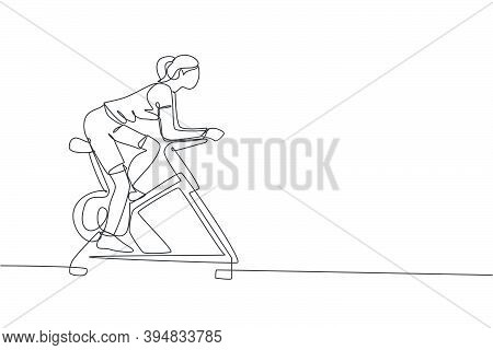 One Continuous Line Drawing Of Young Sporty Woman Working Out Static Stationary Bicycle In Fitness G