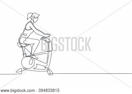 Single Continuous Line Drawing Of Young Happy Woman Exercising With Static Bike In Sport Center Gym