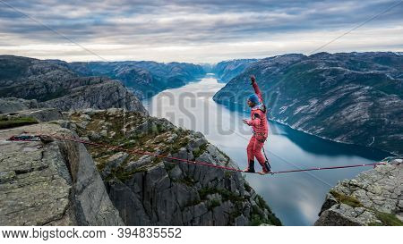 Pulpit Rock, Norway - May 2016: Beautiful Norway Landscape With A Man Walking Over The Rope At Preik