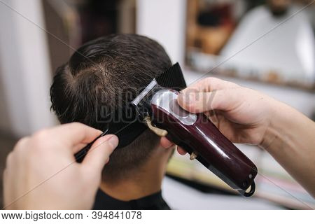 Back View Of Men In Beauty Salon. Mens Haircut In A Barbershop. New Haircut Style 2021. Professional