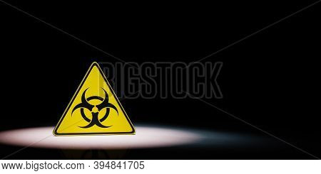 Black And Yellow Pandemic Symbol Warning Triangle Spotlighted On Black Background With Copy Space Re