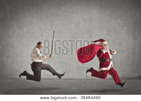 Santa Claus running away from a man who pursues him with a stick