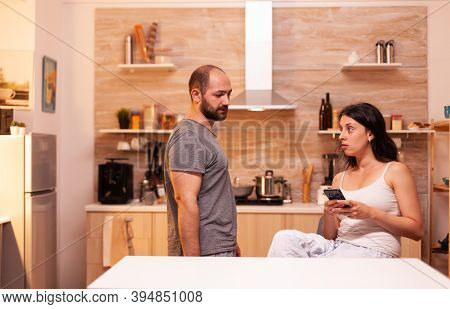 Husband Suspecting Wife Of Cheating With Another Man While Shes Texting. Frustrated Offended Irritat