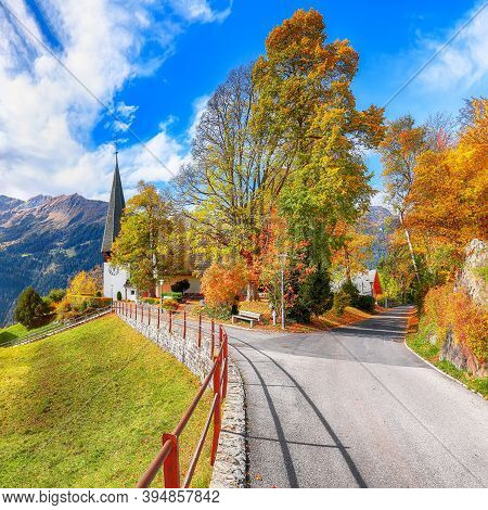 Astonishing Autumn View Of Picturesque Alpine Village Wengen.  Sunny Morning Scene Of Swiss Alps. Lo