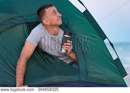 Guy In Morning In Tent With Tourist Mug In His Hands. Camping. Camping. Active Tourism