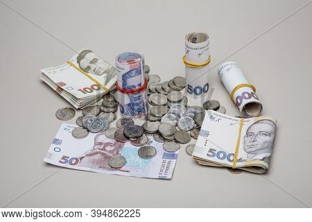 Background From Banknotes And Coins Of The Hryvnia. Ukrainian Money. A Bill In One Thousand Hryvnia,