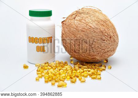 Health Care - Nutritional Supplement And Healthy Food - Bottle Of Coconut Oil With Whole Coconut On