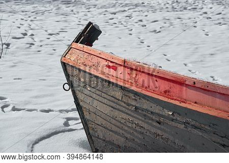 Front Part Of Old Wooden Boat Closeup On Snow Background