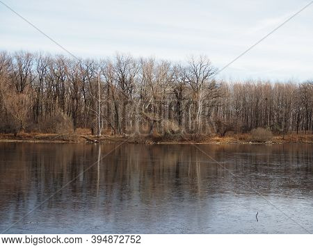 Late Autumn. The First Ice On The Forest Lake. The Hummocks Are Covered With A Thin Layer Of Snow, T