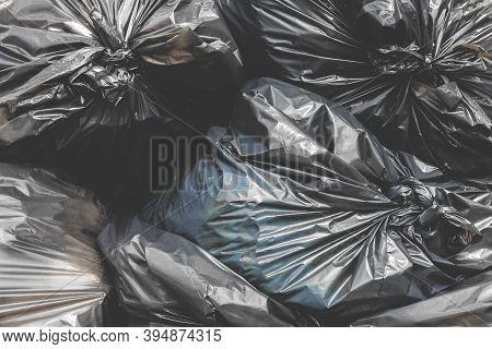 Garbage Pile Black Plastic Bags And Trash Bag Waste Pollution. Stack Of Black Garbage Bags.black Pla