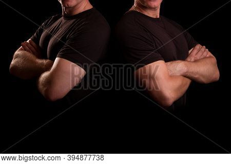 Strong Men On A Black Background. Male Security Guard Concept. Men With Strong Hands. Male Guards In