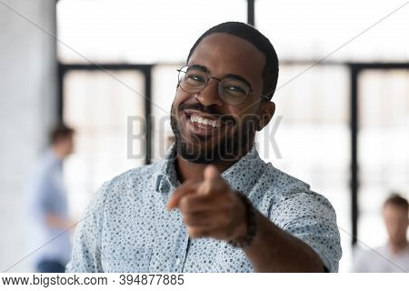 Cheerful Black Male Hr Looking At Camera Pointing To Spectator