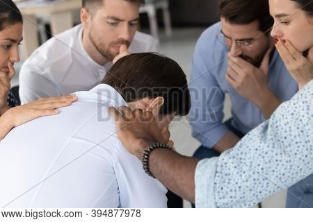 Compassionate Multiethnic Friends Supporting Depressed Man In Hard Life Period