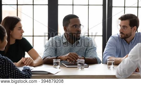 Confident African Ceo Speaking To Diverse Staff On Formal Meeting