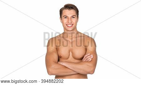 Male Model. Portrait Of Handsome Strong Athletic Guy With Muscular Naked Torso Standing With Folded