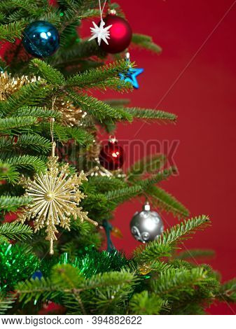 Golden snowflake Christmas ornament on a Christmas tree