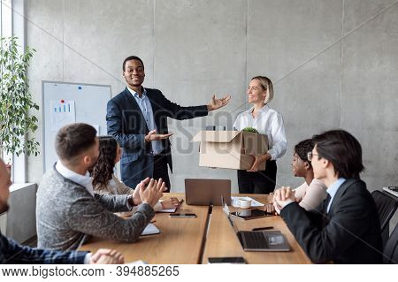 Businessman Introducing New Business Team Member To Employees Coworkers And Colleagues During Corpor