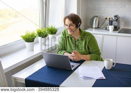An Elderly Woman Makes An Online Video Call Using A Laptop.