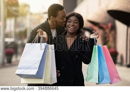 Love And Shopping Together During Big Sale At Black Friday In November. Happy Millennial African Ame