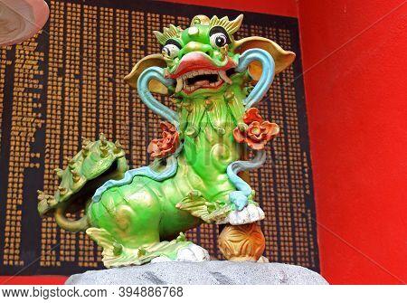 Kuala Lumpur, Malaysia - March 12, 2019: Bright Green Guardian Lion Statue At The Taoist Temple A Gu