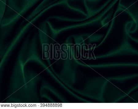 Deep, Rich, Emerald Coloured Satin. Folded And Flowing Background. Decoration Design. Soft Focus. Lu