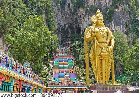 Kuala Lumpur, Malaysia - March 15, 2019: Golden Statue Lord Of Murugan Near Batu Caves Stairs In Kua