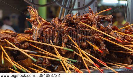 Cooked Chicken Feet On Skewers At Jalan Alor Food Street In Kuala Lumpur. Popular Asian Food. Photo