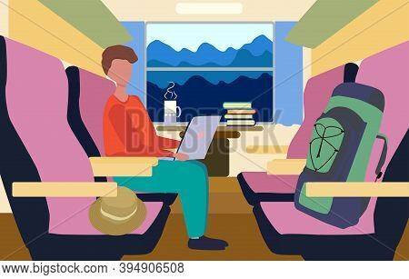 A Man Works At A Laptop In A Train Compartment On The Way Somewhere. Freelance Concept.