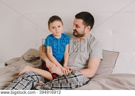 Fathers Day Holiday. Middle Age Caucasian Father Talking To Boy Son. Man Parent Speaking With Child.