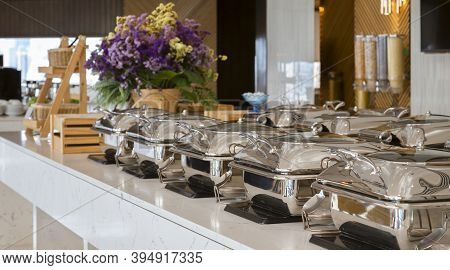 Heating Trays On Buffet Line Ready For Service. Breakfast And Lunch Buffet Food Catering Banquet In