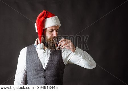 Santa With Glass Of Wine. Red Wine. Santa With Glass Of Wine. Man In New Year Hat Drinks Wine. Alcoh