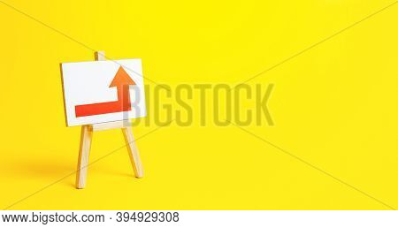 Easel With A Red Right Up Arrow. Direction To Go Around. Bypassing Obstacles And Solving Problems. A